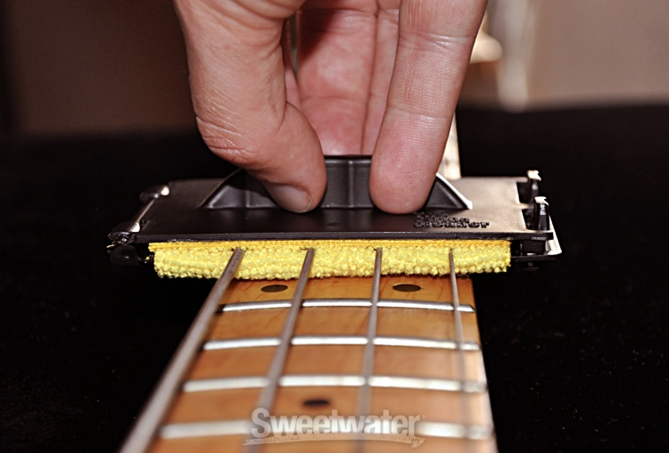 how to clean bass guitar strings