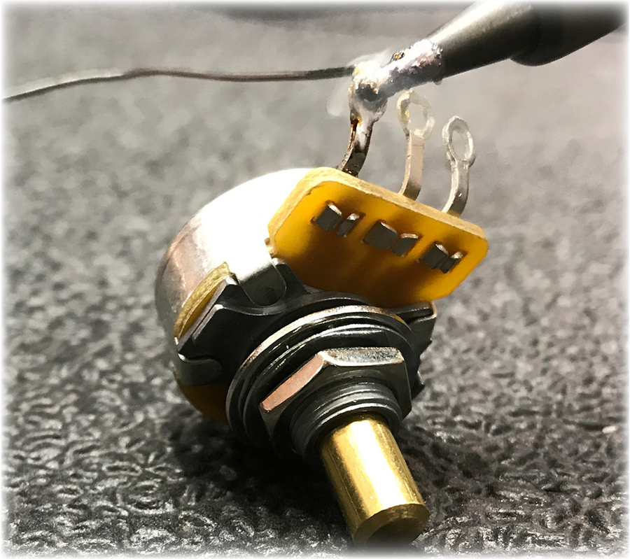 tinning the lug of a potentiometer
